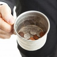 9969439-closeup-of-a-businessman-with-a-tin-cup-begging-for-change--white-background